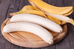 Peeled banana on a wooden board. Close-up Royalty Free Stock Images