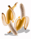 Peeled bananas dancing Stock Photos