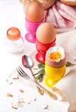 Boiled eggs, salt, bread and ham Royalty Free Stock Image