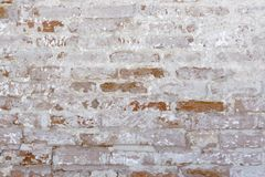 Peeled brick wall Stock Images