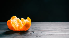 Peeled and canteled mandarin Stock Images