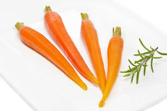 Peeled carrots on white Royalty Free Stock Photos