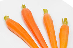 Peeled carrots on white Stock Image