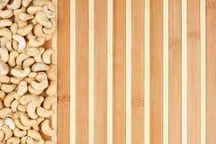 Peeled cashew lying on a bamboo mat Stock Photos
