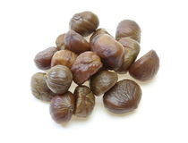 Peeled chestnut. Pictured peeled chestnuts in a white background Stock Photography