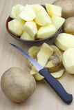 Peeled and chopped potatoes stock images