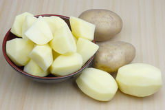 Peeled and chopped potatoes Royalty Free Stock Images
