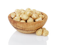 Peeled and cleaned hazelnut kernels in wood bowl Royalty Free Stock Photos