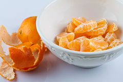 Peeled Clementines In Bowl Stock Photos