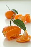 Peeled clementines with leaves Royalty Free Stock Images