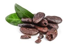 Peeled cocoa bean with leaf isolated on white background Royalty Free Stock Photo
