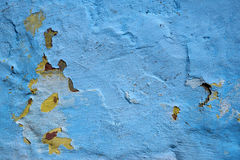 Peeled and Cracked Blue Wall Background with Yellow Stains Royalty Free Stock Photo