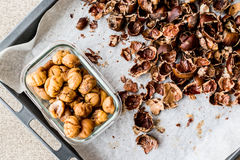 Peeled and crust Chestnuts on tray. Organic food Stock Photography