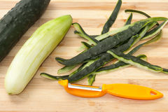 Peeled cucumber with shelled peel Stock Images