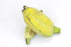 Peeled cultivated banana on white background. Stock Image