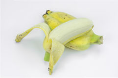 Peeled cultivated banana on white background. Royalty Free Stock Images