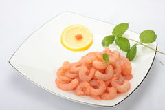 Peeled and deveined shrimp. On white plate Royalty Free Stock Image