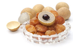 Peeled and dry longan fruit isolated Stock Images