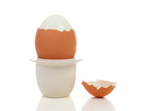 Peeled egg in holder Stock Photos