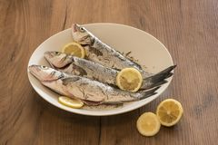 Peeled fresh fish on a white plate royalty free stock photos