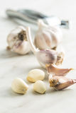 Peeled fresh garlic. Peeled fresh garlic on kitchen table Royalty Free Stock Photos