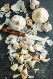 Peeled fresh garlic. Peeled fresh garlic on kitchen table. Top view Royalty Free Stock Photos