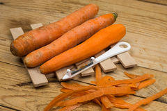 Peeled fresh raw carrots with peeling knife.  Stock Photography