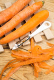 Peeled fresh raw carrots with peeling knife.  Royalty Free Stock Photo