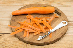 Peeled fresh raw carrots with peeling knife.  Stock Image