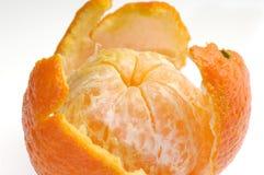 Peeled fruit with orange peel isolated on white Stock Photo