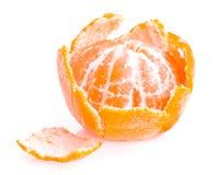 Peeled fruit with tangerine peel. On white background Stock Images