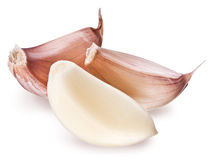 Peeled garlic clove  on a white background. Stock Photo