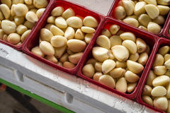 Peeled garlic cloves. At the market Stock Image