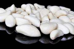 Peeled garlic cloves Royalty Free Stock Photo