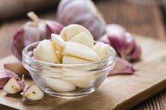 Peeled Garlic (on wood) Royalty Free Stock Photo