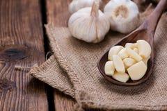 Peeled Garlic (on wood) Stock Image