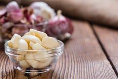 Peeled Garlic (on wood) Stock Photos