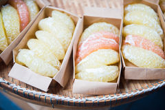 Peeled grapefruit in paper box Royalty Free Stock Image
