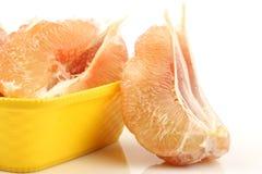 Peeled grapefruit sections. Isolated on white background royalty free stock images