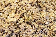 Peeled halves of walnuts on the market close up. Peeled halves of walnuts on the market background, texture close up royalty free stock photos