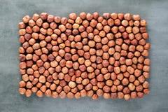 Peeled hazelnuts background Stock Photos