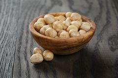 Peeled hazelnuts in bowl Stock Photos