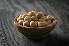 Peeled hazelnuts in bowl Royalty Free Stock Image