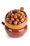 Peeled hazelnuts in a ceramic bowl Stock Image