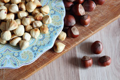 Peeled hazelnuts on a plate Royalty Free Stock Image