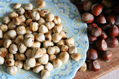 Peeled hazelnuts on a plate Stock Photos