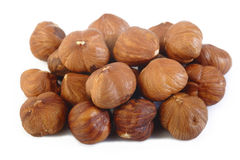 Peeled hazelnuts on white background Stock Photos