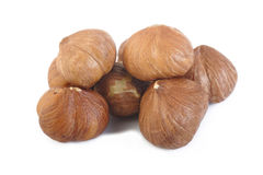 Peeled hazelnuts on white background Stock Photo