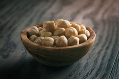 Peeled hazelnuts in wooden bowl Royalty Free Stock Image