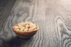 Peeled hazelnuts in wooden bowl Royalty Free Stock Photo